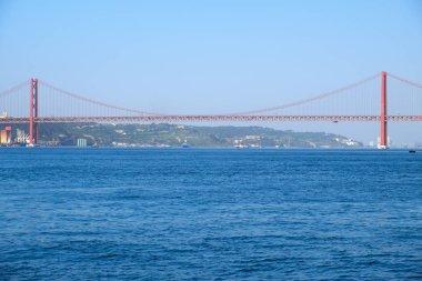 25th of April Bridge suspension bridge over river Tejo in Lisbon