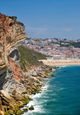 Rocks between Farol De Nazare and Nazare beach and town