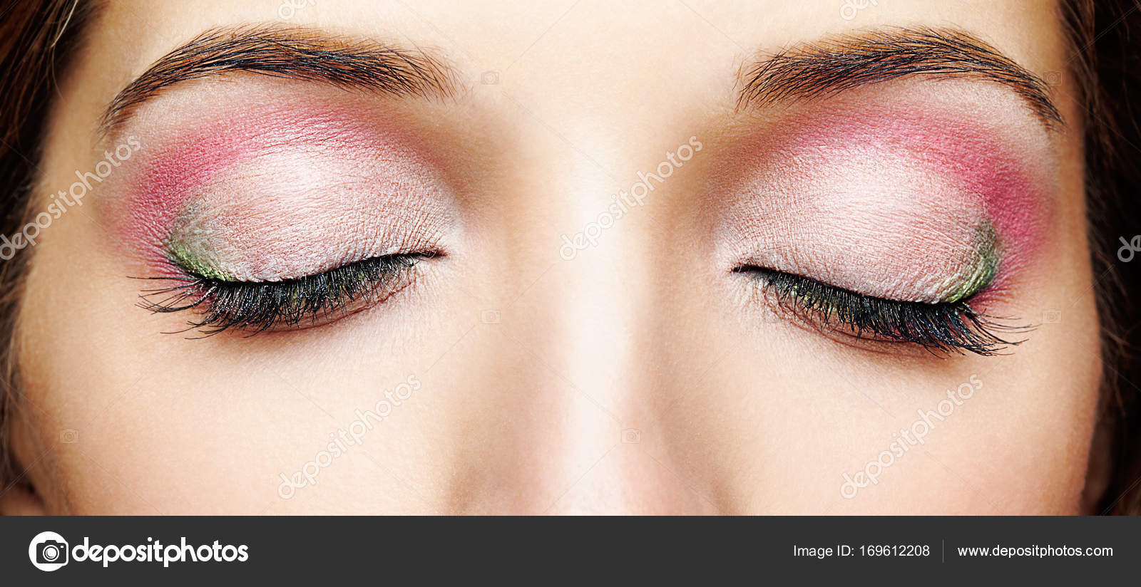 Closeup Shot Of Woman Face With Closed Eyes And Pink Green Mak