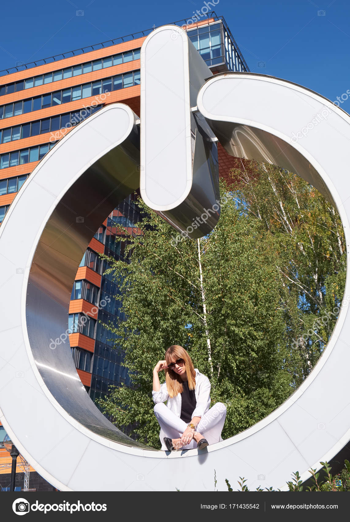 Modern young woman on the steps of symbol of information technol novosibirsk akademgorodok russia september 03 2017 modern young woman in white clothes near symbol of information technology center in akademgorodok biocorpaavc Images
