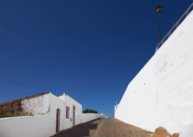A Street with white houses in the small town of Mertola. Portuga
