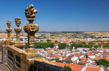 Decorative stone torches on the balcony of Evora Cathedral (Se).