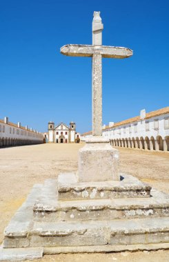 Stone cross in front of the Church of Our Lady of the Cape near