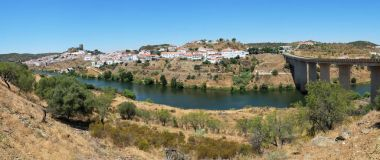 The panoramic view of Mertola town and the bridge over the Guadi
