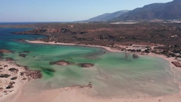 Aerial view video from drone on Elafonisi sandy beach on Crete. Elafonissi is one of the most known world beaches and is famous for pink sand. Kissamos, Chania prefecture, Crete Island, Greece.