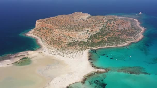 Aerial view from moving back drone on Tigani cape and Balos lagoon with sandy sea beach. Dimos Kissamou, Chania prefecture, Crete, Greece.