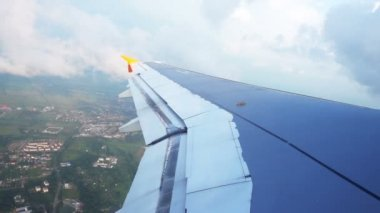 Wing of airplane taking off