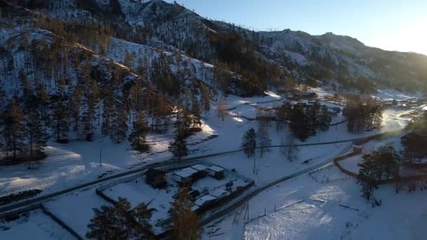 beautiful aerial shot of winter village, mountain winter resort in Altai