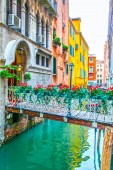 Small bridge with flowers in Venice