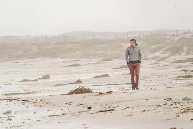man at Pacific coast beach