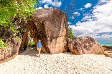 Woman walking at beautiful Seychelles beach, Praslin, Anse Lazio stock vector