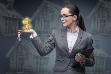 Businesswoman in housing mortgage concept