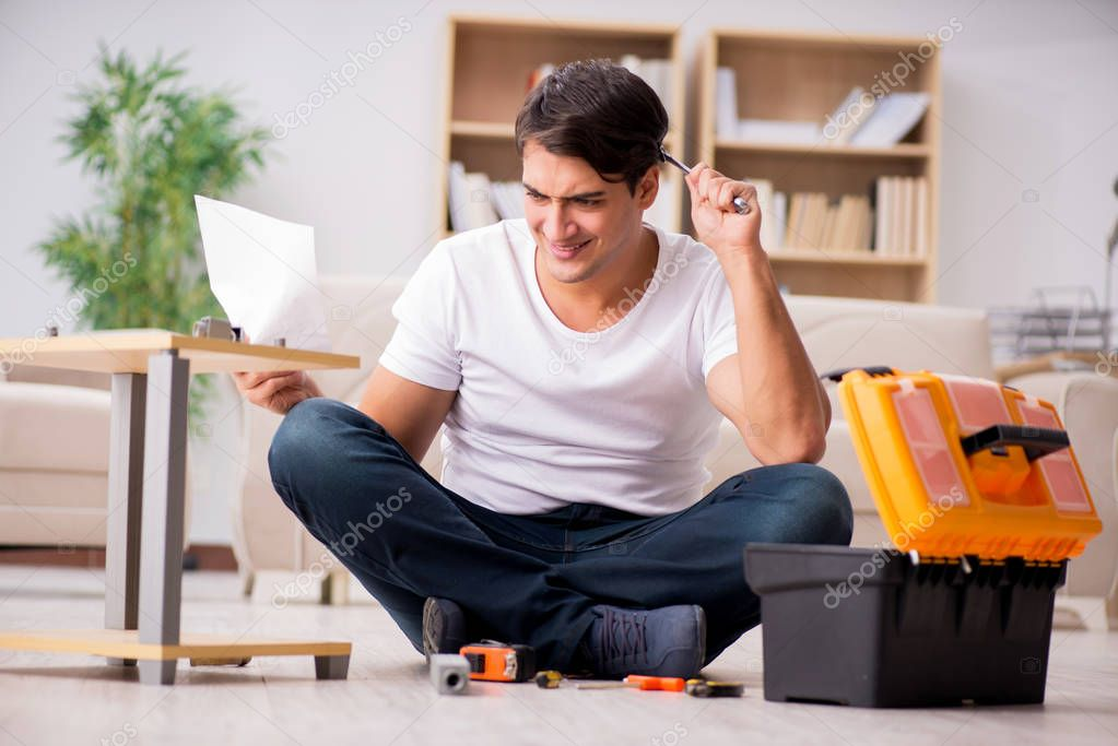 Man assembling shelf at home