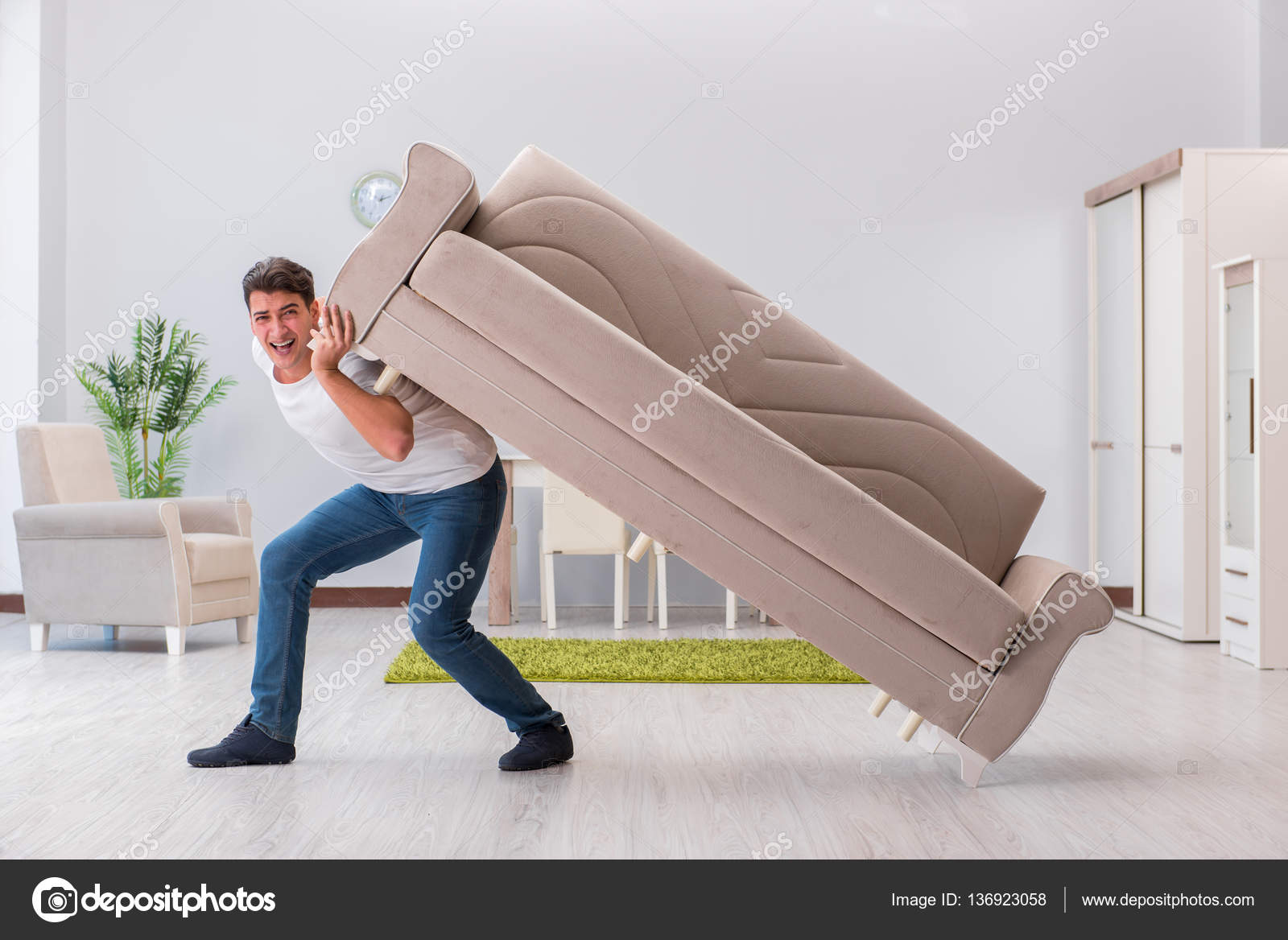 Man Moving Furniture At Home U2014 Stock Photo