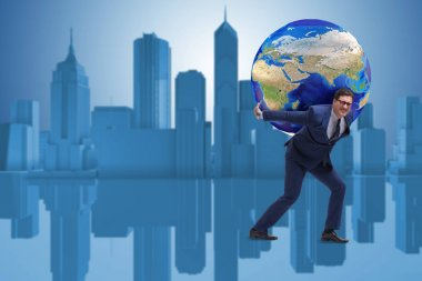 Businessman carrying Earth on his shoulders
