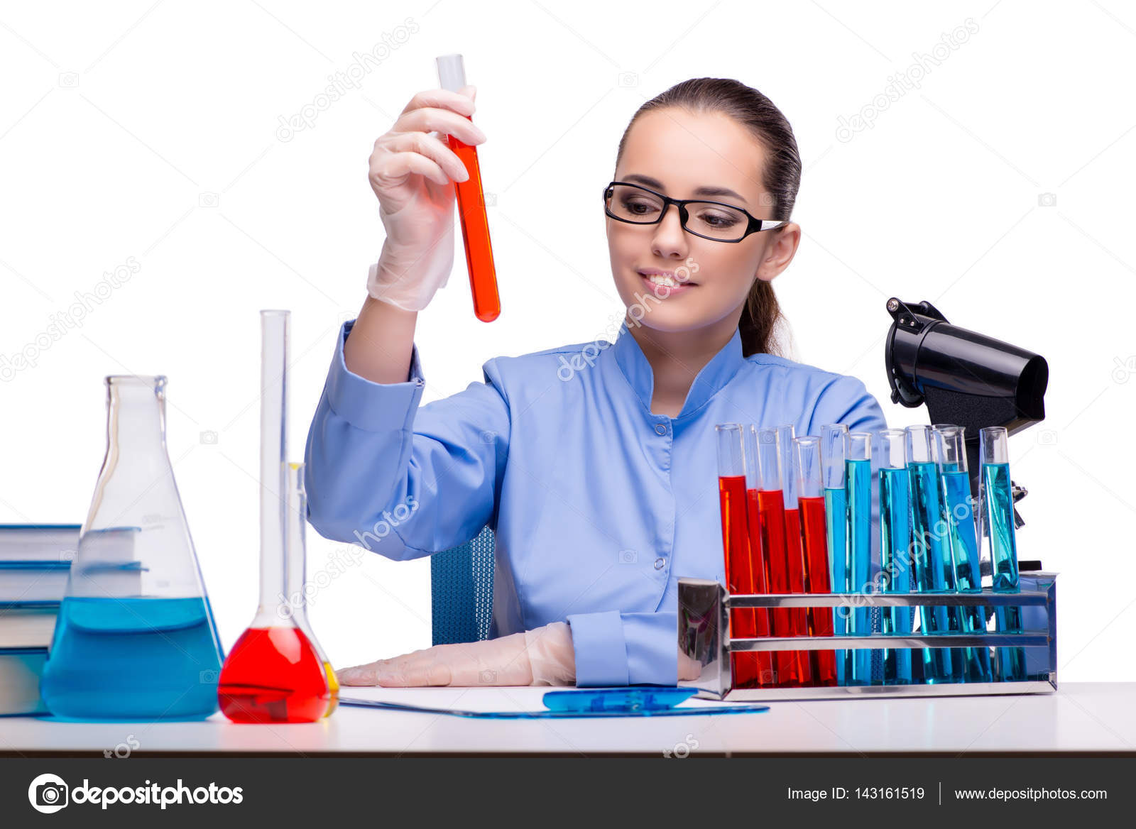 lab chemist working with microscope and tubes stock photo