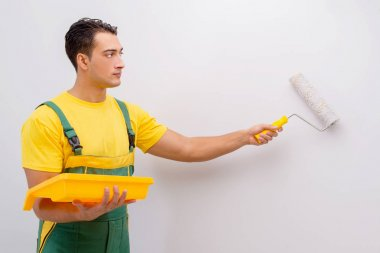 Man painting the wall in DIY concept