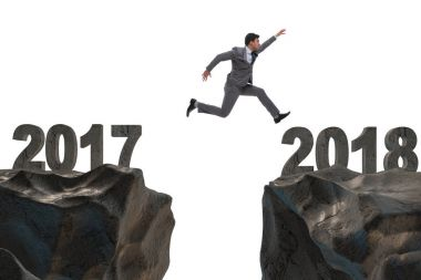 Businessman jumping from 2017 to 2018