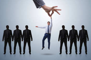 Recruitment concept with hand picking employee