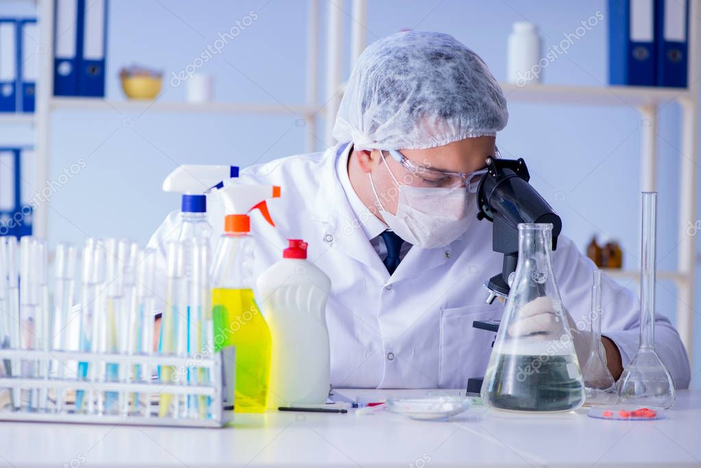 Man in the lab testing new cleaning solution detergent
