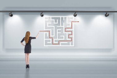 Businesswoman is looking for ways to escape from maze labyrinth