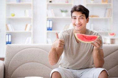 Man eating watermelon at home stock vector