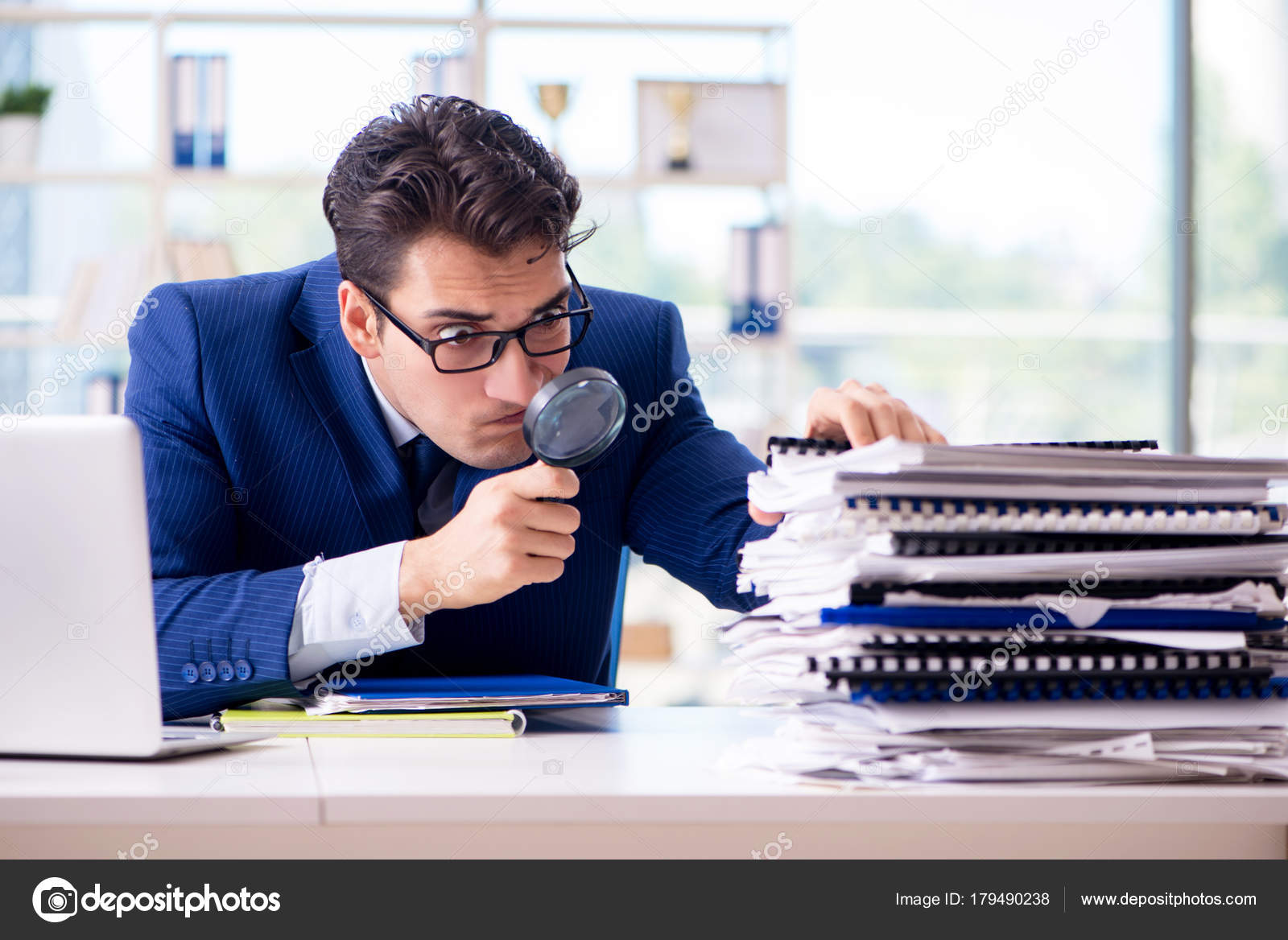 auditor looking for errors in the financial statements stock photo