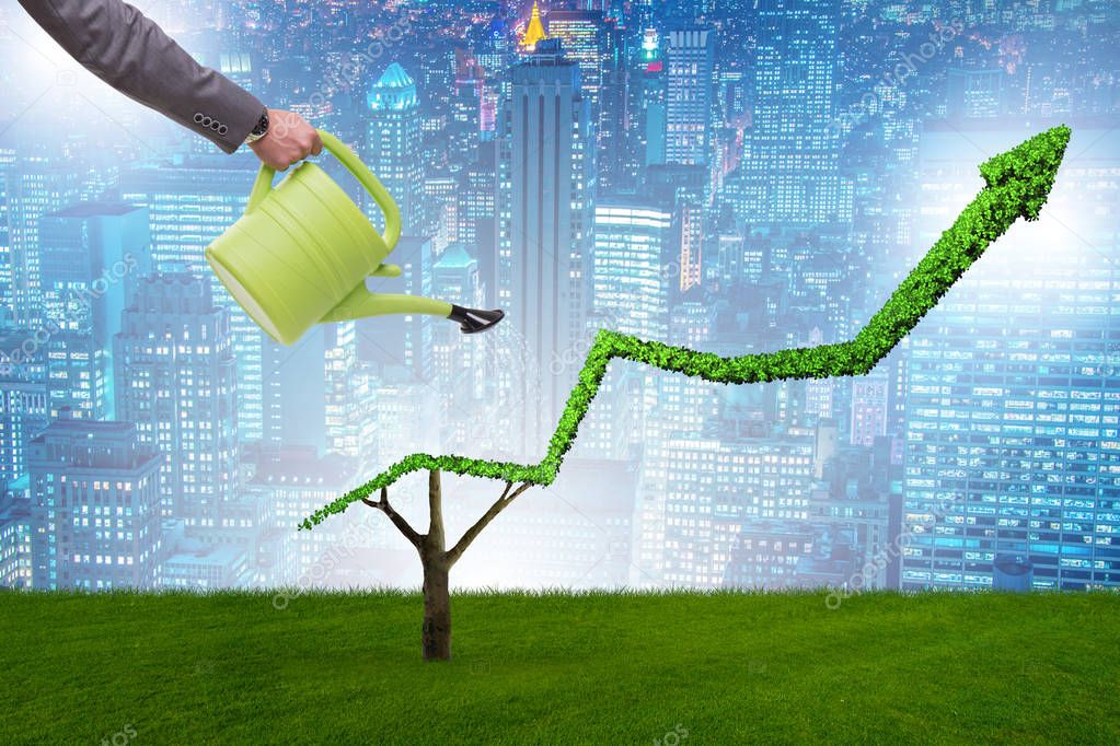 Businessman in investment concept watering financial line chart