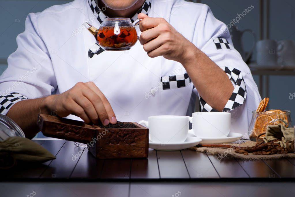 Tea expert brewing cup of drink