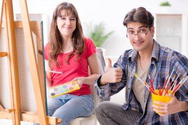 Artist coaching student in painting class in studio stock vector