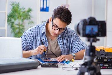 Vlogger recording computer repair on camera for vlog blog stock vector