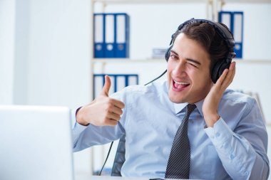Sales assistant listening to music during lunch break