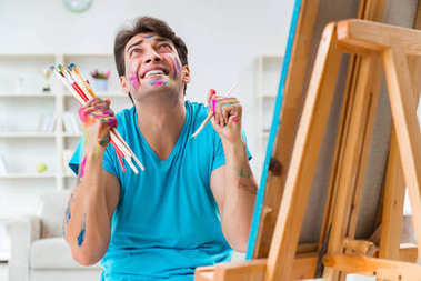 Young funny artist working on new painting in his studio stock vector