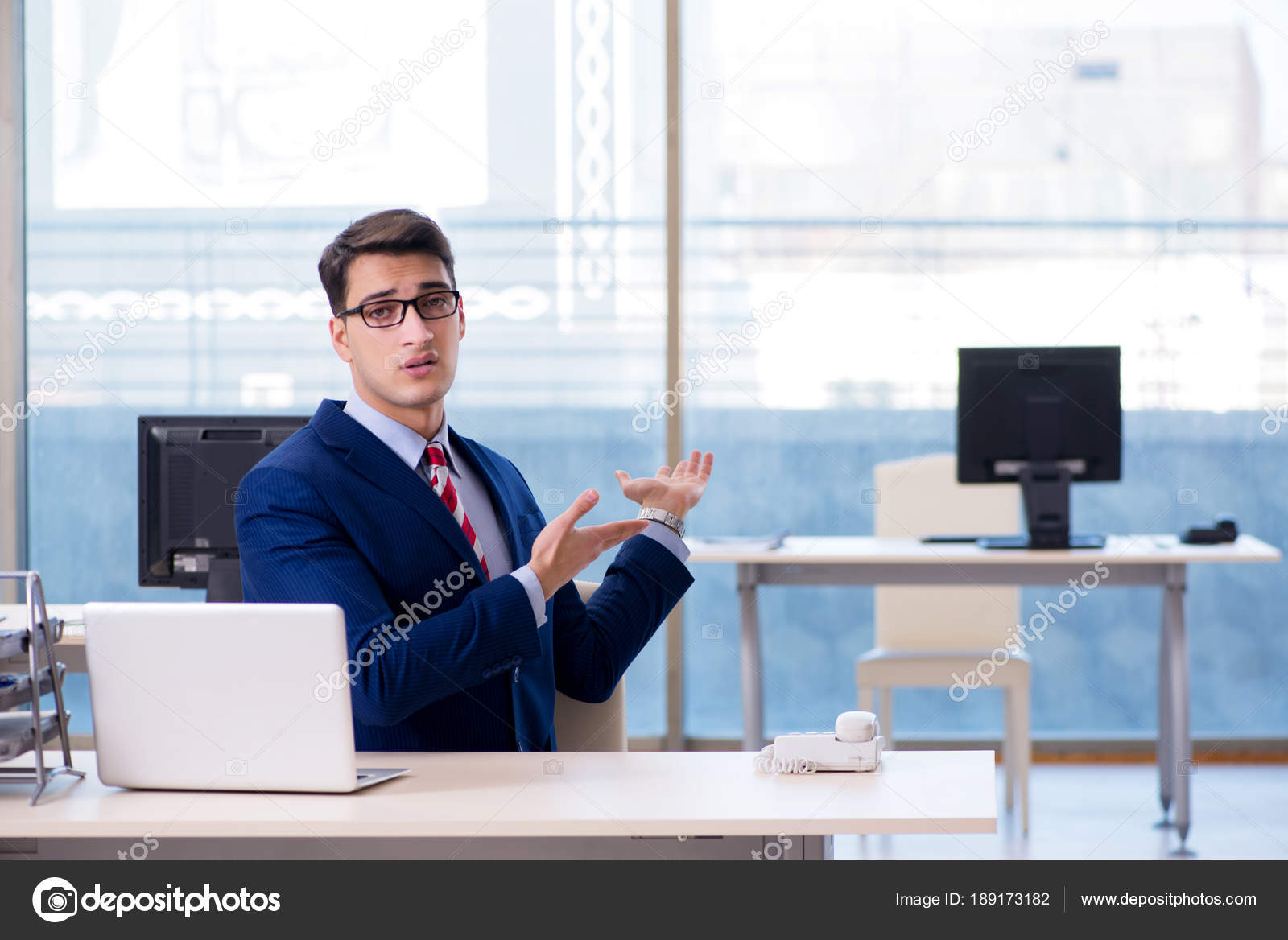 businessman employee unhappy about absent employee stock photo