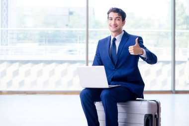 Businessman waiting for his flight at airport stock vector