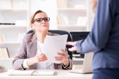 Angry boss dismissing employee for bad underperformance