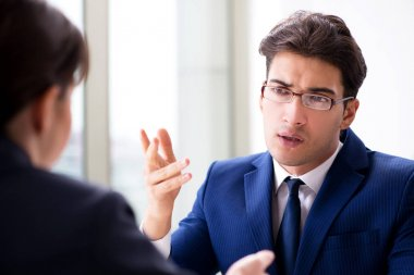 Lawyer talking to his client in office