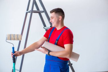 Contractor worker preparing for wallpaper decoration
