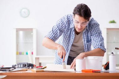 Young man in woodworking hobby concept