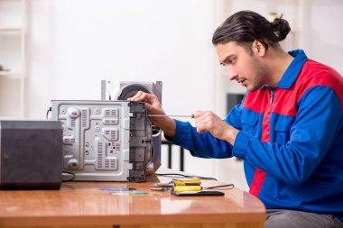 Young engineer repairing musical hi-fi system