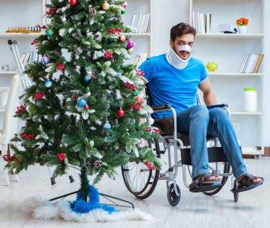 Injured disabled man celebrating christmas at home