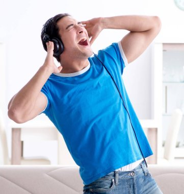 Young man singing at home karaoke