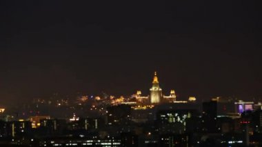 Fireworks over night city with the Moscow State University