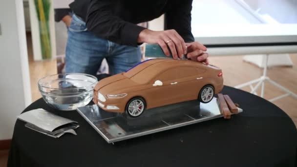 man making clay model of car stock video paha l 146849343. Black Bedroom Furniture Sets. Home Design Ideas