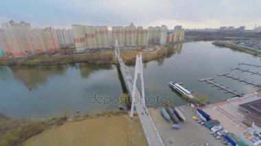 Urban sector with pedestrian bridge over river