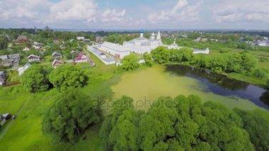 Pond among plants near Saint Trinity Danilov cloister and village