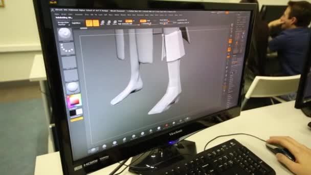 Student working with 3D model on computer