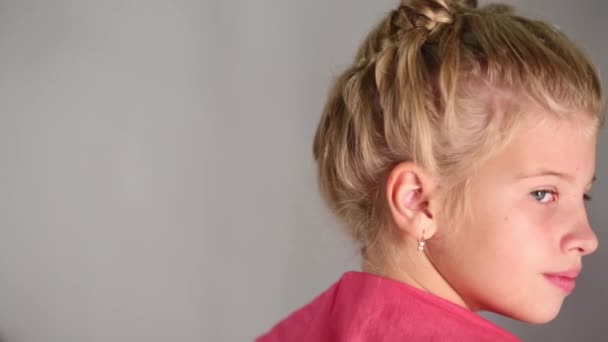 girl with beautiful hairdo turns head