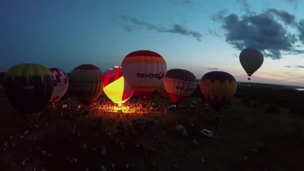 air balloons starting fly from field