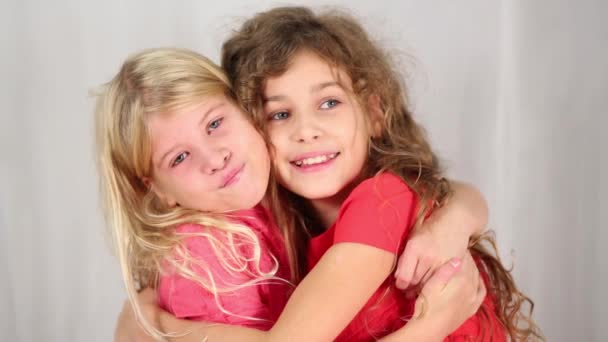 Two pretty girls in white studio
